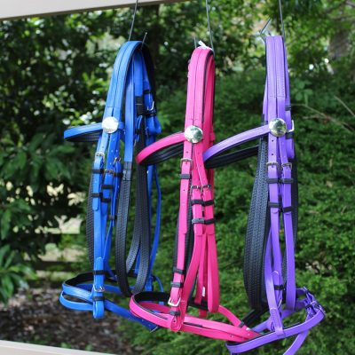 Super Horse Saddlery have a good selection of quality PVC bridles with matching reins available in Blue, Pink and Purple.